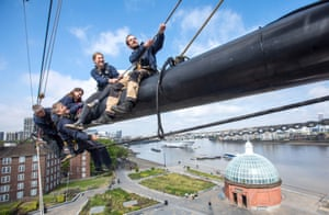 London, UK: Chris Wood (right) and his team undertake maintenance work on the 152ft masts of the Cutty Sark as they prepare for the ship's 150th anniversary next month.