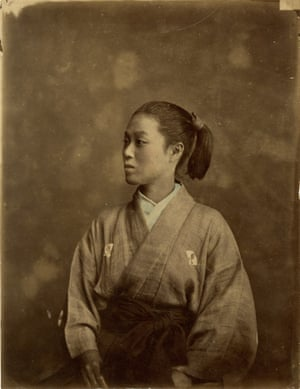 Swordswoman in fencing outfit, c1875.Hand-coloured albumen print from wet collodion negative. Founded in 1873, the 'Gekken-kai', or fencing association repackaged traditional samurai fighting into a profitable spectacle for the public. Drawn from the samurai class, group included several women, and their demonstrations of skill with the naginata, or polearm sword, proved a popular draw in tours across Japan. Although an integral part of the samurai armoury, the naginata was more generally accepted as a weapon used by aristocratic women and often formed part of a samurai daughter's dowry