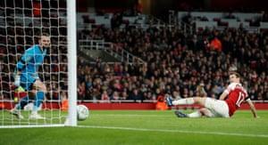 Arsenal's Stephan Lichtsteiner scores their first goal