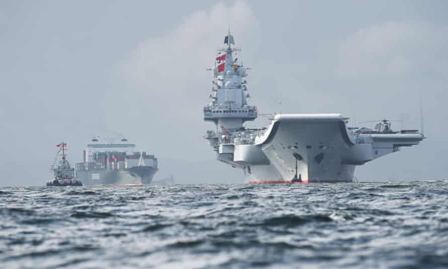 China's first carrier, the three-decade-old, 66,000-tonne Liaoning, arrives in Hong Kong waters on 7 July 2017.