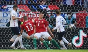 France's Antoine Griezmann scores their first goal.