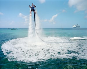 "From THE HEAVENS, ANNUAL REPORT series. An employee of ""Jetpack Cayman"" demonstrates this new watersport, now available on the island"