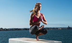 Woman practicing yoga on concrete block