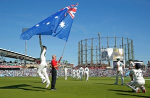 Cricketeer Nathan Lyon jumps to touch the Australian flag on day three of the 5th Ashes test match at The Oval in London