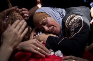 A Palestinian woman mourns over her son in 'Aqqaba, West Bank