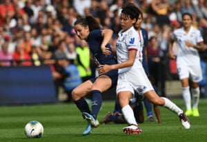 Paris Saint-Germain's Sara Dabritz holds off Lyon's Saki Kumagai during the Champions Trophy final in September 2019.
