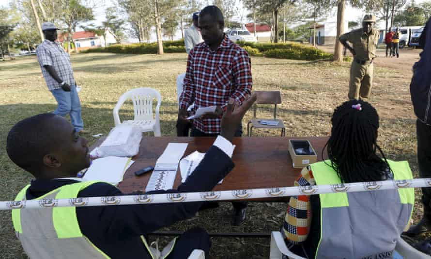 A voter's identity is verified at a polling station in Kirihura, western Uganda.