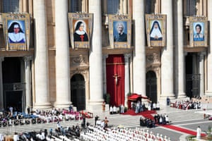 Vatican City, Italy. Tapestries of new saints: Brazilian Dulce Lopes Pontes, Italian Giuseppina Vannini, England's John Henry Newman, Indian Mariam Thresia Chiramel Mankidiyan and Swiss Marguerite Bays are displayed during their canonisation mass in Saint Peter's Square
