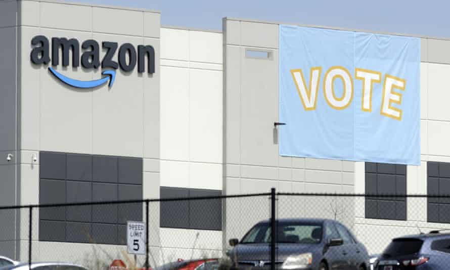 A banner encouraging workers to vote in labor balloting is shown at an Amazon warehouse in Bessemer, Alabama, late March.