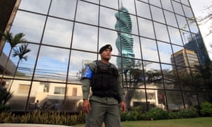 A police officer stands guard outside the headquarters of Mossack Fonseca, in Panama City.
