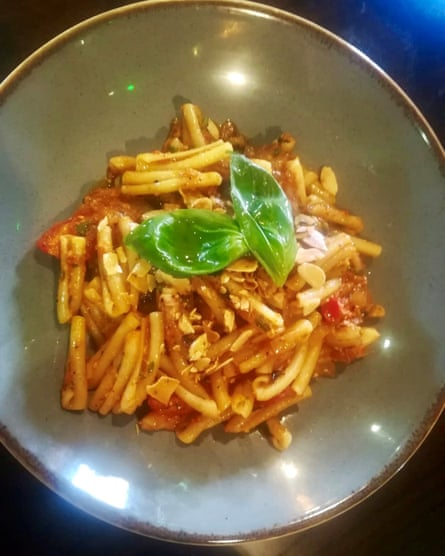 Casarecce pasta, red pepper, almond and smoked garlic pesto, confit onion and basil at Salvo's.