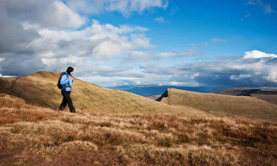 A hiker in the Brecon Beacons national park near Pen y Fan.