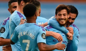 David Silva, who made Manchester City's first goal against Newcastle, is congratulated after scoring their fourth.