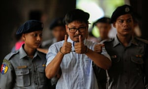 Detained Reuters journalist Wa Lone arrives for a court hearing in Yangon in June