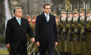 Viktor Orbán, left, and Mateusz Morawiecki review troops outside the Hungarian parliament in Budapest, 3 January 2018.