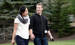 A file picture dated 11 July 2013 of Mark Zuckerberg (R), chief executive officer and founder of Facebook Inc., and wife Priscilla Chan (L).