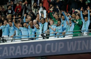 Man-of-the-match Kompany lifts the trophy for the third time.