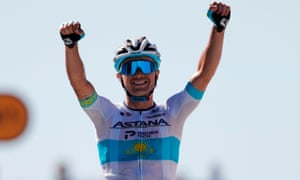 Alexey Lutsenko punches the air after winning the sixth stage of the 2020 Tour de France.