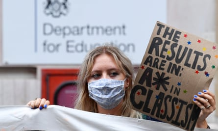 Student holding sign saying A* in classism