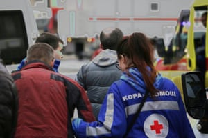 Rescuers help an injured person