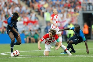 Luka Modric goes down under an early challenge from N'Golo Kanté. There;s no way the French are letting arguably the tournament's best player have an easy ride today.