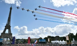 French aerial patrol 'Patrouille de France' fly over the Eiffel Tower