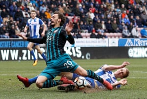 Southampton's Manolo Gabbiadini is fouled by Wigan Athletic's Dan Burn resulting in a penalty for Southampton at the DW Stadium.