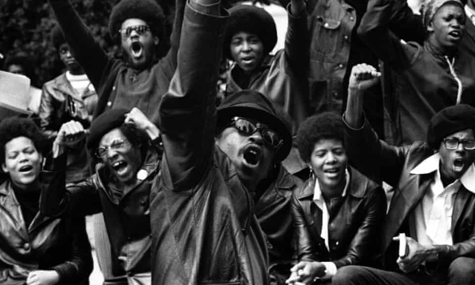 Black Panthers salute during a rally in support of jailed member Huey Newton, in Provo Park, Berkeley, California, 1968.