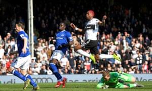 Ryan Babel scores Fulham's second goal against Everton.