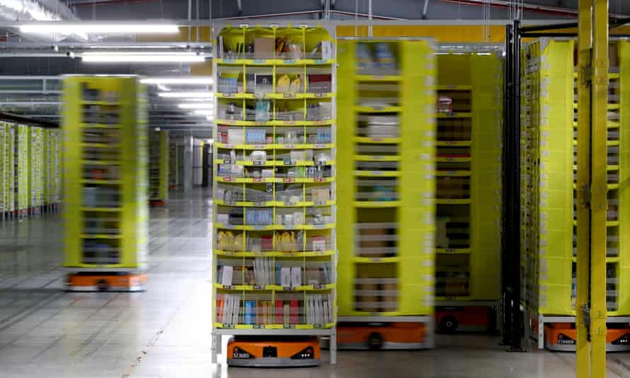 products on robotic racks at the amazon fulfilment centre in tilbury, essex
