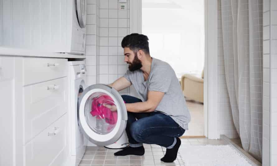 a man checks his washing machine