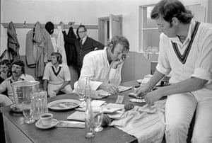 Doug Walters, centre, plays cribbage with team-mate Rick McCosker in the Australian dressing room during the 1st Ashes test match against England at Edgbaston, Birmingham in July 1975
