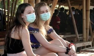 Tourists wear protective masks in Sanur, Indonesia