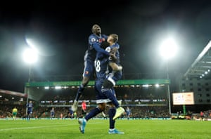 Gray celebrates with Abdoulaye Doucoure and Gerard Deulofeu.