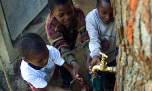 Children at a communal tap near Cape Town.