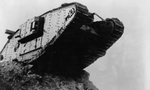 A British tank advances over trenches on the Western Front.