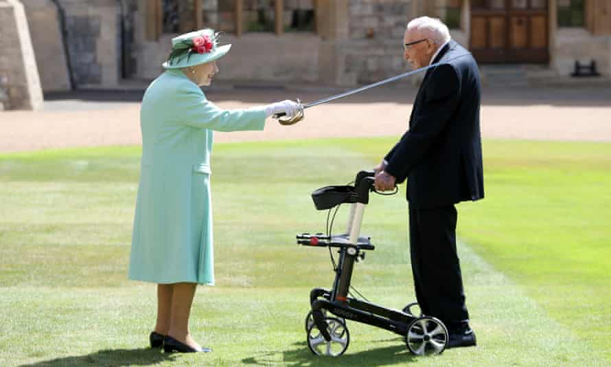 Cpt Sir Tom Moore being knighted by the Queen in the grounds of Windsor Castle