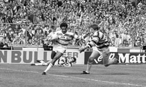 Wigan's John Ferguson (left) hands off the Hull captain Lee Crooks on his way to scoring his side's fifth try.