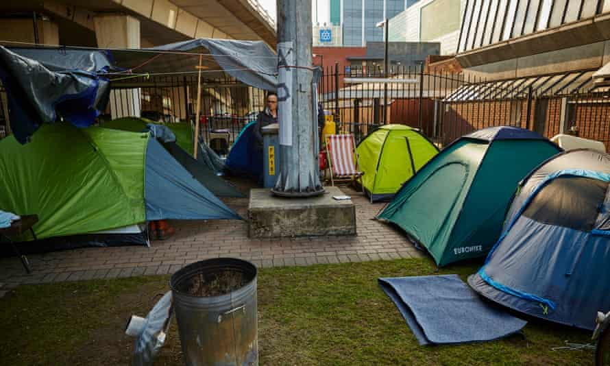 A homeless protest camp under the elevated Mancunian Way, one of many set up across the city centre since April.