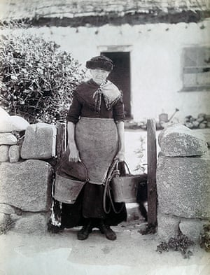 A woman sets off to fetch water from the communal well