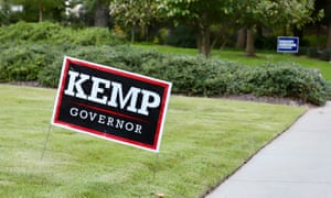 In an Atlanta neighborhood, a solitary Brian Kemp sign of support stands out amid a sea of Stacey Abrams signs.