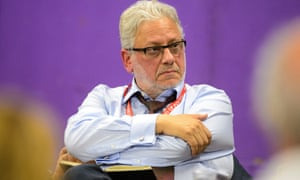 Jon Lansman, the chair of Momentum, with his arms folded and looking stern