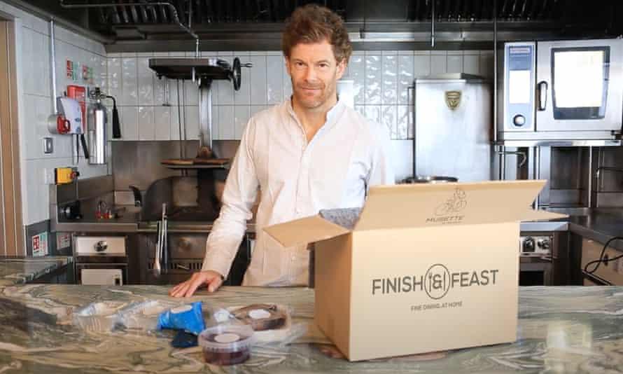 Tom Aikens at a kitchen work surface with a Finish & Feast cardboard box