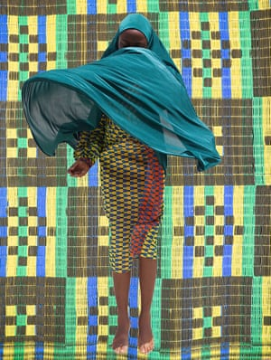 Women in Lagos wearing the veil or hijab while dancing by visual artist Medina Dugger.