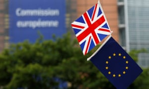 A British Union flag and an EU flag are seen flying outside the European commission headquarters in Brussels.