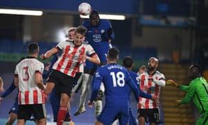 Chelsea's Kurt Zouma heads clear.
