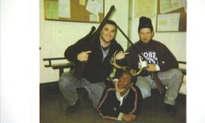Former Chicago police officers Jerome Finnigan, left, and Timothy McDermott holding rifles over a black man in antlers.