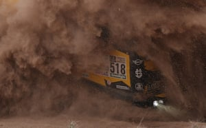 The Liaz truck of driver Martin Macik, co-driver Frantisek Tomasek and mechanic Michal Mrkva is engulfed by dust