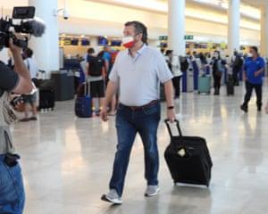 Sen Ted Cruz checks in for a flight at Cancun International Airport.