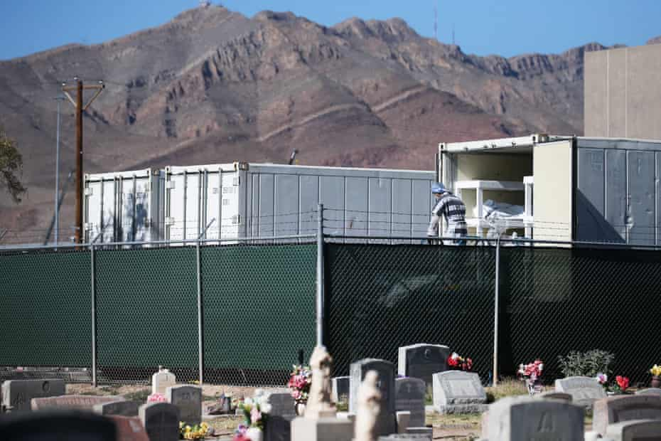 Inmates from the El Paso county detention facility prepare to load bodies into a refrigerated temporary morgue on 16 November.